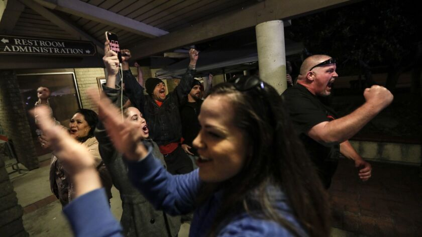 Spectators cheer as the Los Alamitos City Council votes to oppose California's sanctuary state law.