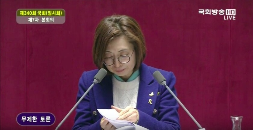 South Korean lawmaker Eun Soo-mi is shown on TV delivering remarks for 10 hours in parliament as part of the first filibuster since 1969.