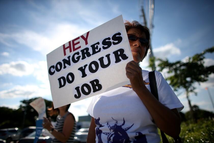 Activists Protest Against Government Shutdown In Miami