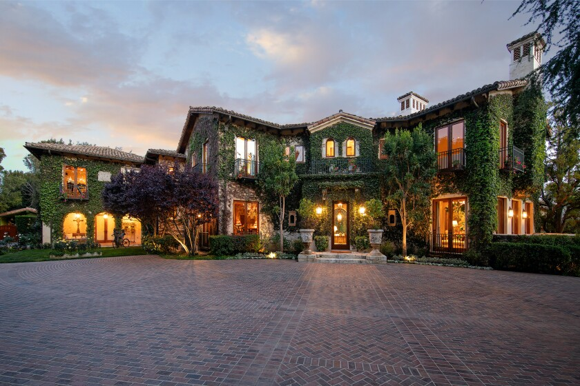 The 1.8-acre spread centers on a 16,700-square-foot villa built by Richard Landry.