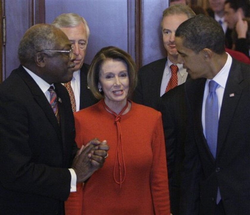 President Barack Obama, right talks with House Speaker Nancy Pelosi, D-Calif., and Majority Whip James Clyburn, D-S.C., left, after meeting with House Democrats about health care on Capitol Hill in Washington, Saturday, Nov. 7, 2009.(AP Photo/Alex Brandon)