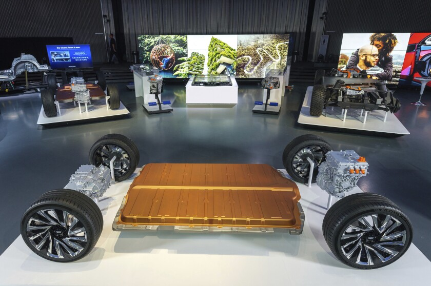 This photo provided by General Motors shows GM's all-new modular platform and battery system, Ultium, at the Design Dome on the GM Tech Center campus in Warren, Mich., on Wednesday, March 4, 2020. GM rolled out plans for 13 new electric vehicles during the next five years as it trying to refashion itself as a futuristic company with technology to compete against Tesla. The company on Wednesday touted an exclusive new battery technology that could propel some of the vehicles as far as 400 miles (644 kilometers) on a single charge. (Steve Fecht/General Motors via AP)