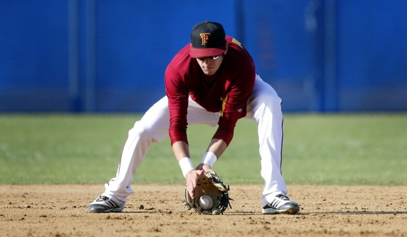Torrey Pines shortstop Morgan Oliver fields the ball for the No. 2-ranked Falcons.