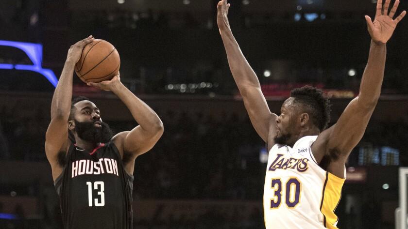 Houston Rockets guard James Harden shoots a 3-pointer over Los Angeles Lakers forward Julius Randle