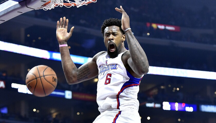 Clippers center DeAndre Jordan reacts after dunking against the Rockets in the first half of Game 6.
