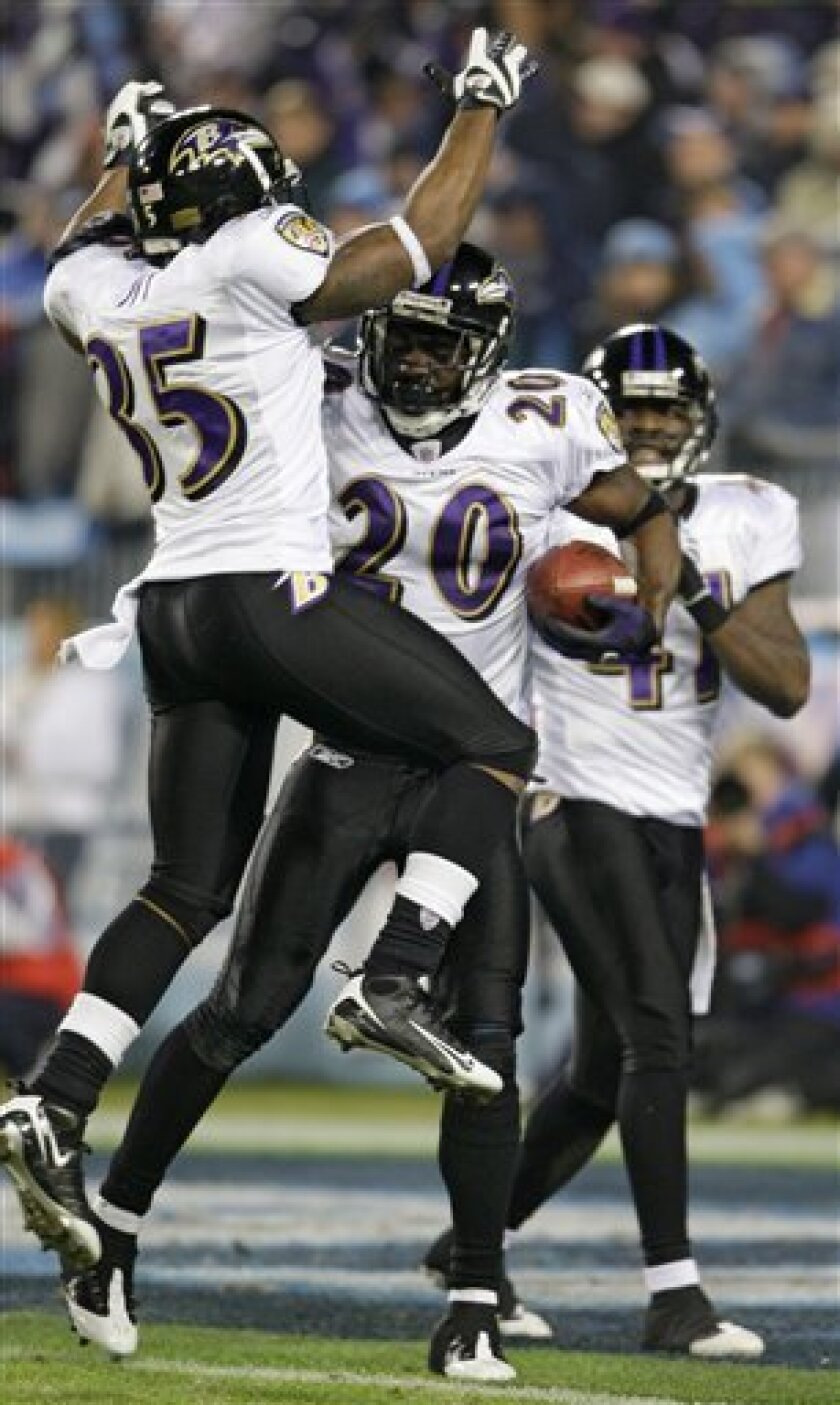 Baltimore Ravens safety Ed Reed (20) holds the game ball as he celebrates with cornerback Corey Ivy (35) and cornerback Frank Walker (41) after the Ravens defeated the Tennessee Titans 13-10 in an NFL divisional playoff football game in Nashville, Tenn., Saturday, Jan. 10, 2009. (AP Photo/Mark Hump