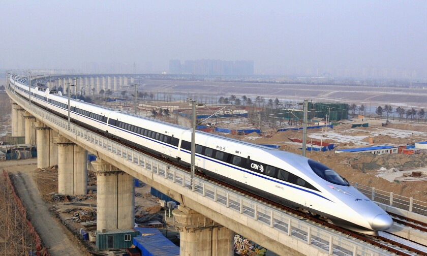 A bullet train passes over Yongdinghe Bridge in Beijing in December 2012. Mexico's government has yanked a contract worth nearly $4-billion from a Chinese-led consortium to build a high-speed rail line.