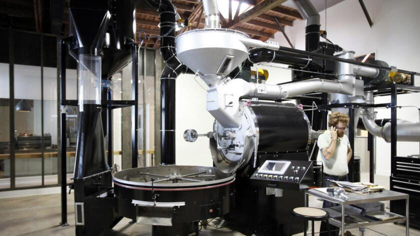 Spencer Moody works on the coffee roaster at Stumptown Coffee Roasters in the Arts District in downtown Los Angeles.