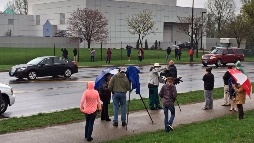People stand outside entertainer Prince's Paisley Park compound in Chanhassen, Minn., in April 2016.