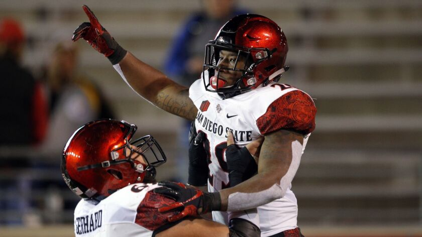 San Diego State running back Juwan Washington, right, celebrates with teammate Nick Gerhard after sc
