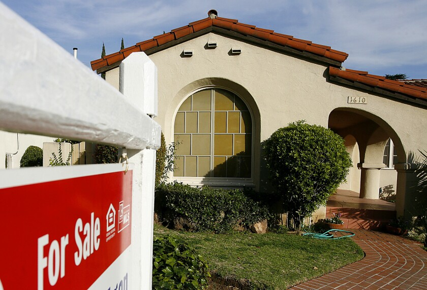 A house for sale is seen in Glendale in this February 2009 file photo.