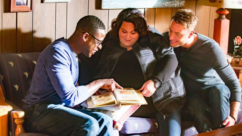 Sterling K. Brown, left, as Randall, Chrissy Metz as Kate, Justin Hartley as Kevin in a scene from ""