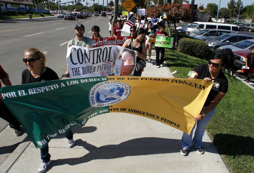 May 1, 2013, Vista, California_ USA_| About 150 grassroots organizations and community members from Escondido, San Marcos, Vista, Fallbrook, and Oceanside walk along N. Santa Fe Avenue as the came together this Wednesdayt in conmemoration of International Workers' Day.