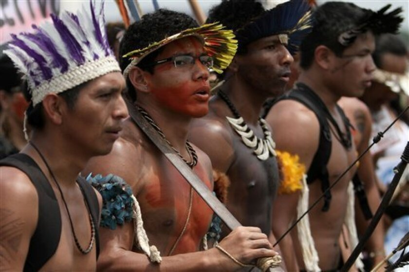 Indian men from various tribes protest in defense of the Guarani-Kaiowa tribe who are involved in a land dispute in Brasilia, Brazil, Wednesday, Oct. 31, 2012. A court has ordered the Guarani-Kaiowa Indians to surrender their territories in the western state of Mato Grosso do Sul to landowners who claim it as theirs. The indigenous community of about 170 members is asking for the demarcation of their land's borders and say they will fight for the right to their lands. (AP Photo/Eraldo Peres)