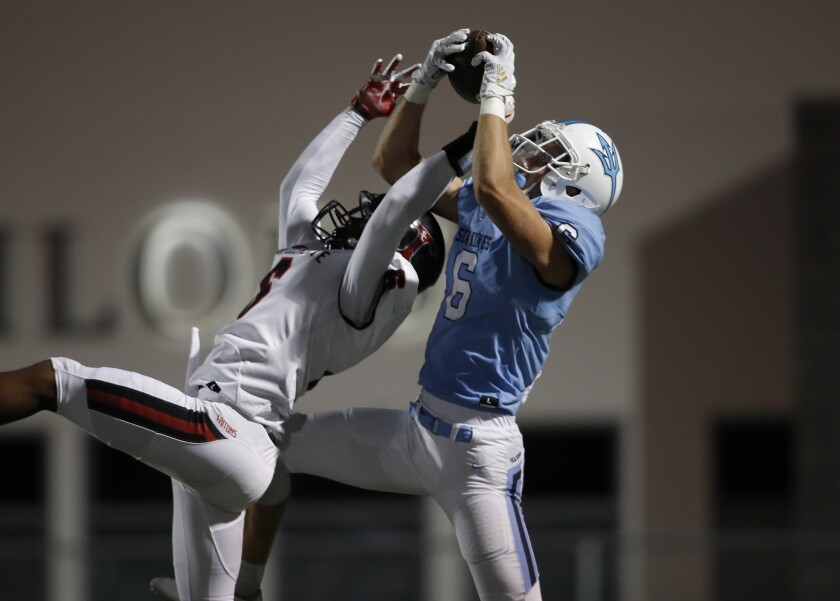 Corona del Mar wide receiver John Humphreys makes a touchdown reception over San Clemente's Nick Billoups during the their game Thursday.