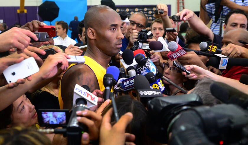 Lakers guard Kobe Bryant is surrounded by reporters and photographers during media day in El Segundo.