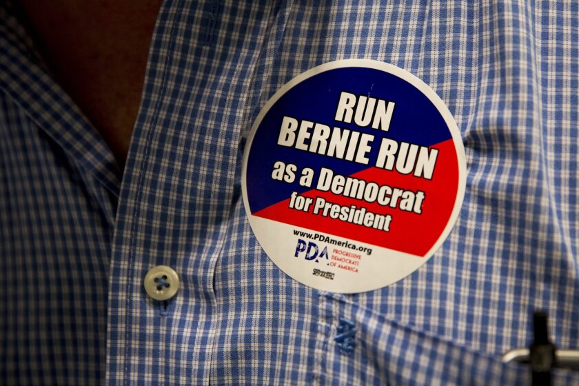An audience member wears a campaign button for Sen. Bernie Sanders, who announced his candidacy for the Democratic presidential nomination on April 30, at a town hall meeting in Maryland on May 5.