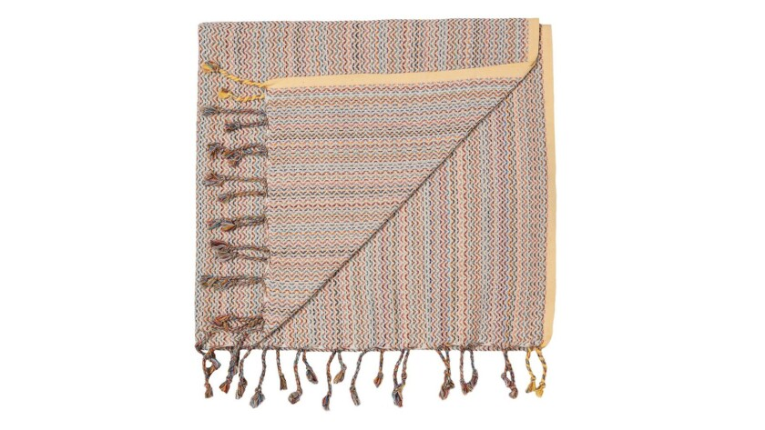 Mayde Dry off with Mayde's tasseled Turkish towel, which can double as a wrap when the wind picks