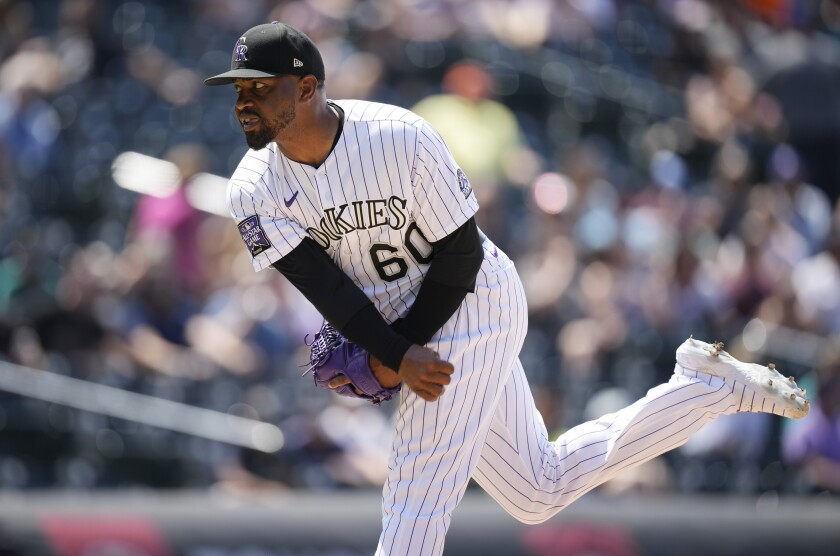 Colorado Rockies relief pitcher Mychal Givens works against the Seattle Mariners in the seventh inning of a baseball game Wednesday, July 21, 2021, in Denver. (AP Photo/David Zalubowski)