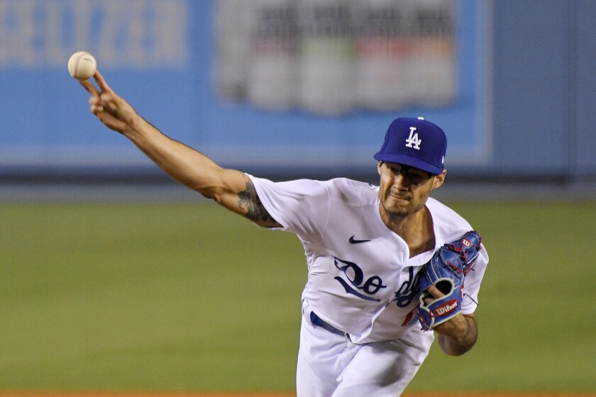 Los Angeles Dodgers relief pitcher Joe Kelly throws to the plate during the eighth inning of a baseball game against the San Francisco Giants Friday, Aug. 7, 2020, in Los Angeles. (AP Photo/Mark J. Terrill)