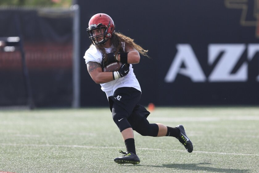 Aztecs Linebacker Jake Fely runs through pass coverage drills during the first practice of the 2015 season for San Diego State University football.