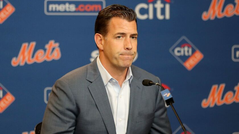 New York Mets general manager Brodie Van Wagenen answers questions during a news conference on May 20.