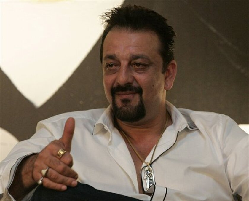 """FILE - In this June 5, 2010 file photo, Indian Bollywood actor Sanjay Dutt speaks during a press conference promoting his new Bollywood film """"Knock Out"""" at the International Indian Film Academy awards event in Colombo, Sri Lanka. India's Supreme Court gave Dutt more time to finish films before he g"""