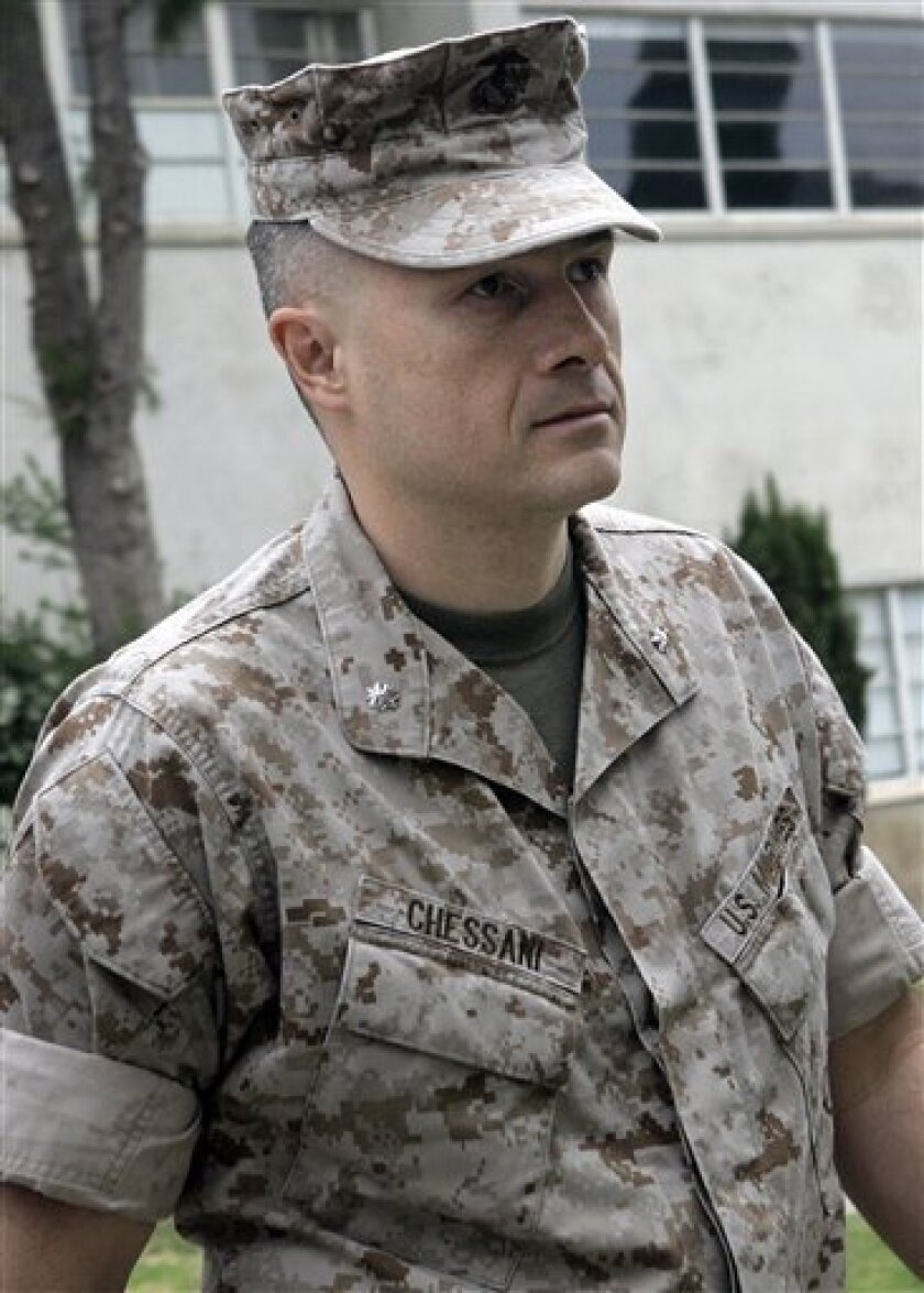 FILE - This May 30, 2007 file photo shows U.S. Marine Lt. Col. Jeffrey R. Chessani arriving at a preliminary hearing where he is charged with violation of a lawful order and dereliction of duty at Camp Pendleton, Calif. A military panel is convening at Camp Pendleton on Wednesday Dec. 2, 2009 to decide whether Chessani should be demoted for failing to investigate the deaths of 24 Iraqis in Haditha in November 2005. (AP Photo/Lenny Ignelzi, File)