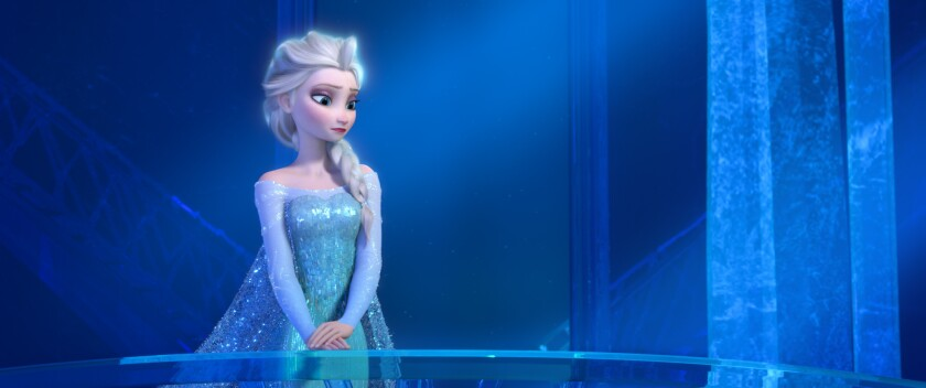 "The character Elsa appears in a scene from the Disney movie ""Frozen."""