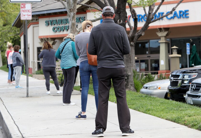 A long line of shoppers stood out to Gould Avenue, where wait times were estimated at 45 minutes, to get into Trader Joe's grocery store on Foothill Boulevard in La Cañada Flintridge on Tuesday, April 7, 2020.