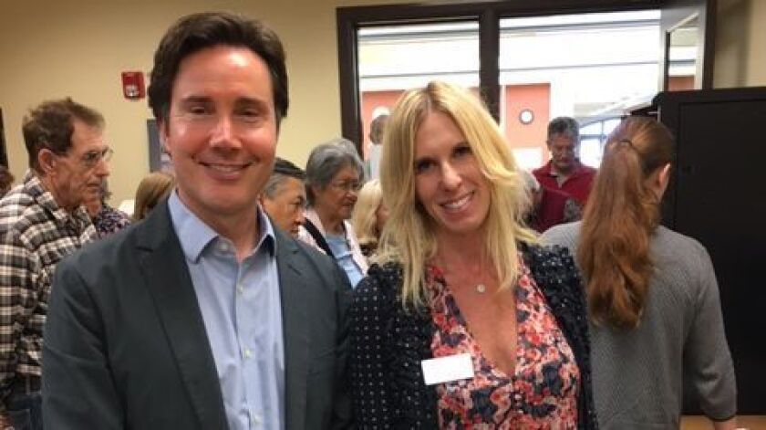 La Jolla Library branch manager Shaun Briley with Las Patronas investment committee chair Lauren Wei