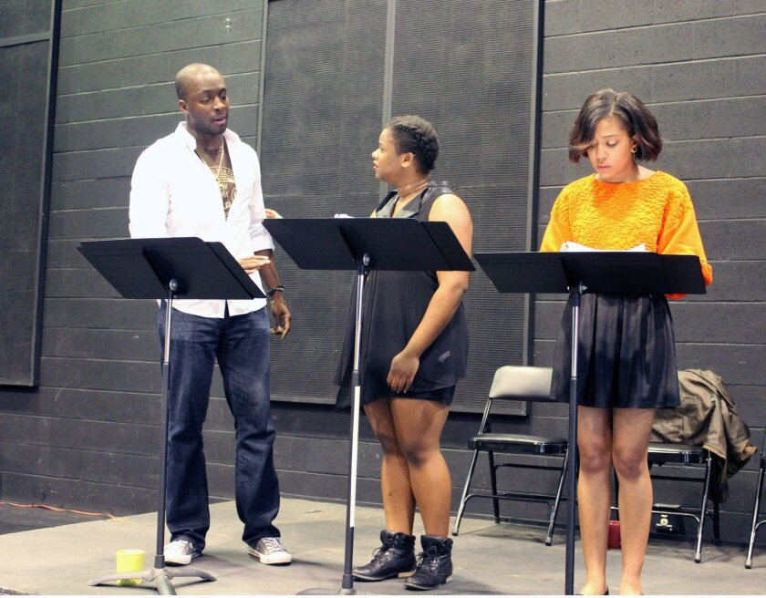 """Andy Lucien, Tesiana Elie and Zora Howard (left to right) in last year's DNA New Work Series reading of """"Krik? Krak. Or the Last Tiger in Haiti."""" Jeff Augustin's play (now titled simply """"The Last Tiger in Haiti"""") will receive a full production in the theater's 2016-17 season."""