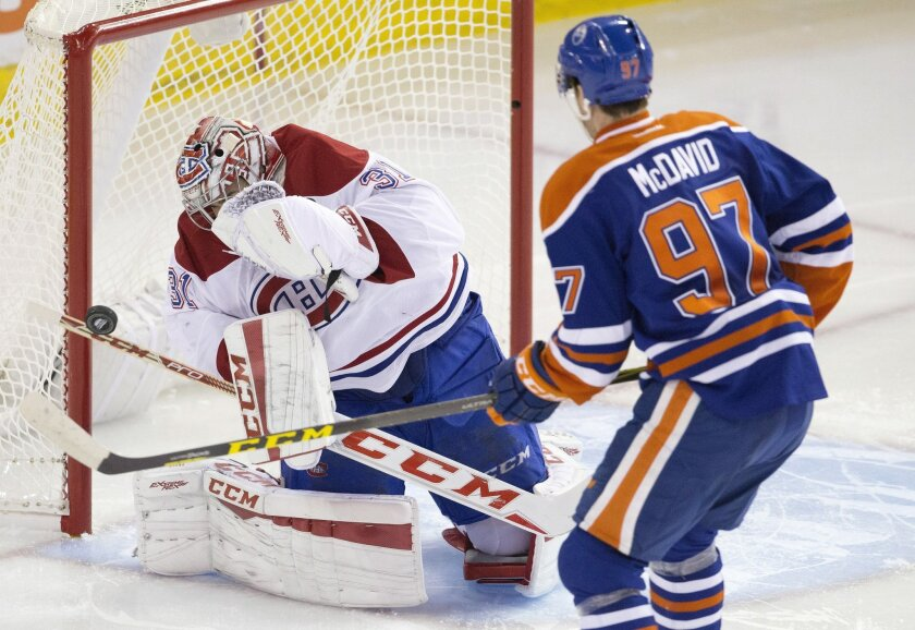 Montreal Canadiens goalie Carey Price (31) makes the save on Edmonton Oilers' Connor McDavid (97) during second period NHL action in Edmonton, Alberta, on Thursday, Oct. 29, 2015. (Jason Franson/The Canadian Press via AP)