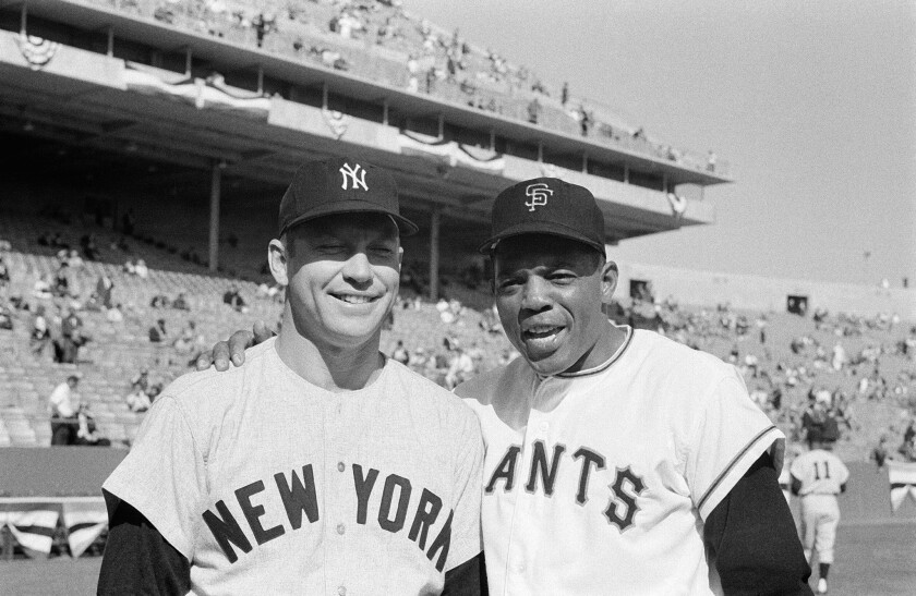 Mickey Mantle and Willie Mays, seen posing together here before the 1962 World Series, both were banned from baseball at one time.