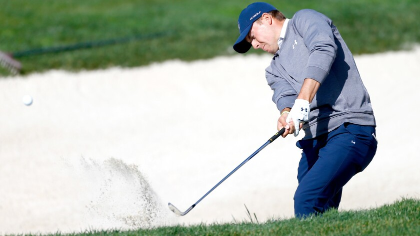 Jordan Spieth hits from a greenside bunker at No. 6 during the third round of the AT&T Pebble Beach Pro-Am on Saturday.
