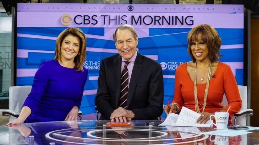 """Norah O'Donnell, left, Charlie Rose and Gayle King on the set of """"CBS This Morning"""" in New York."""