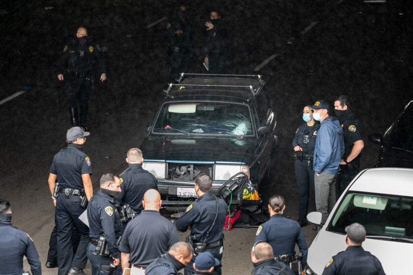 nvestigators survey the scene of a crash that killed at least three people on March 15, 2021.