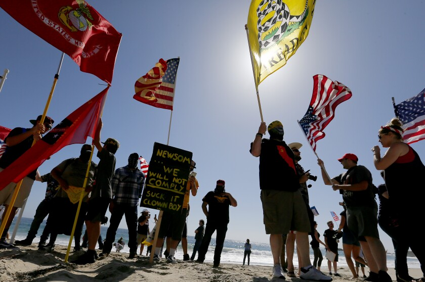 People gather in Laguna Beach in May to protest Gov. Gavin Newson's order temporarily closing Orange County beaches