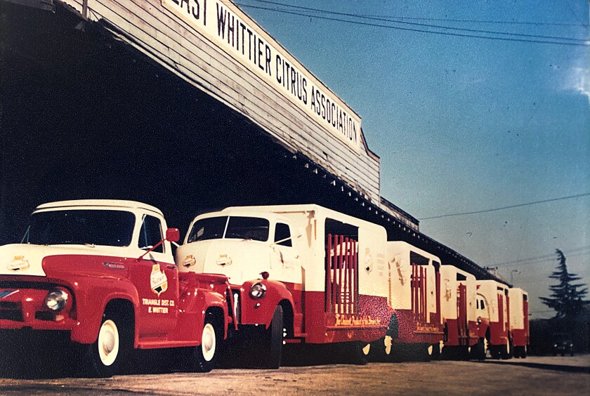 Delivery trucks line up at a warehouse in Whittier.