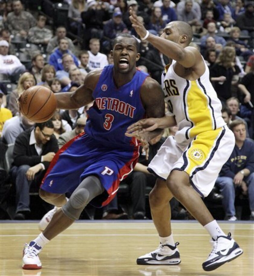 Detroit Pistons guard Rodney Stuckey, left, moves to the basket in front of Indiana Pacers guard A.J. Price during the first half of an NBA basketball game in Indianapolis, Friday, Feb. 5, 2010. (AP Photo/AJ Mast)