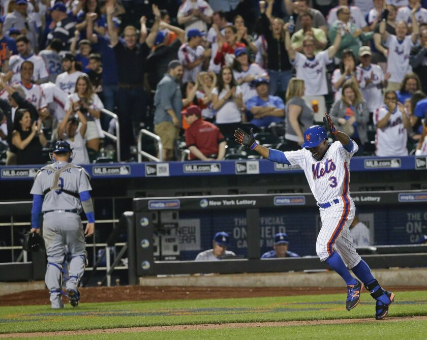 New York Mets' Curtis Granderson (3) heads to home plate after hitting a walk-off home run as Los Angeles Dodgers catcher Yasmani Grandal (9) leaves the field during the ninth inning of a baseball game Friday, May 27, 2016, in New York. (AP Photo/Frank Franklin II)