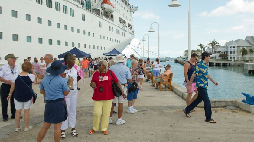In this photo provided by the Florida Keys News Bureau, passengers from the Empress of the Seas walk