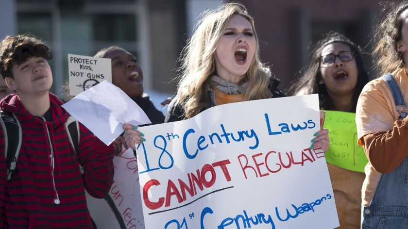 Paying tribute to the Parkland victims at town hall in Farmington, Maggie McGuire, 17, a Farmington High School senior, at center, led about 75 students in chants during the national walkout against gun violence on March 14.