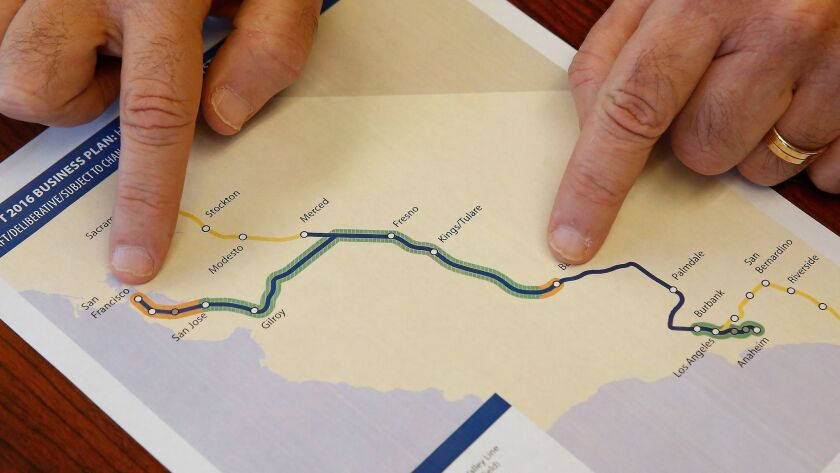 Dan Richard, chairman of the board that oversees the California High-Speed Rail Authority, displays a map showing the planned route for the bullet train.