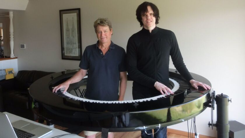 Creative force Dave Starkey with Lady Gaga's pianist Brockett Parsons in Starkey's La Jolla home where they fine-tuned development of the circular piano.