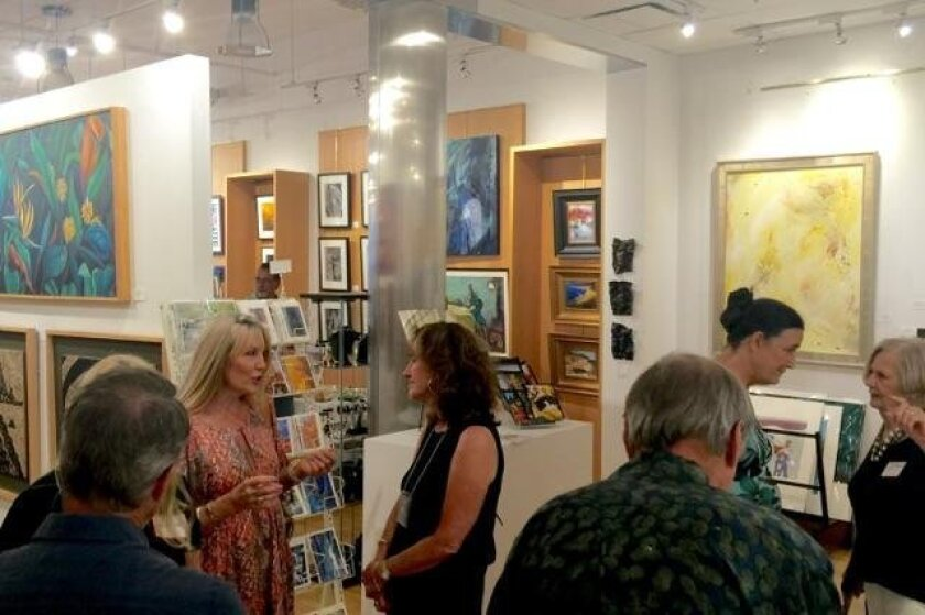 Guests mingle at the opening reception for 3rd quarter artwork at the Del Mar Art Center.