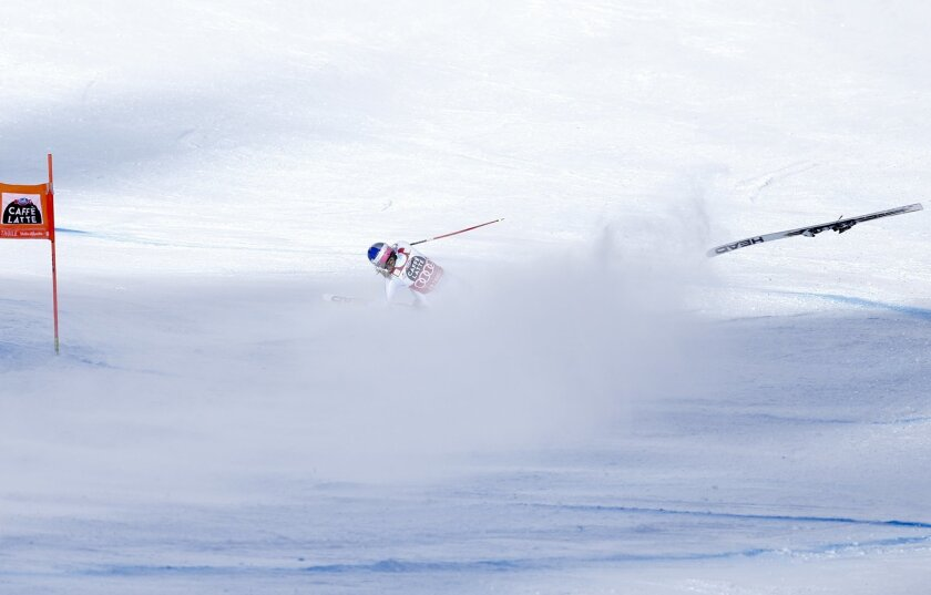 United States' Lindsey Vonn crashes during a women's Alpine ski downhill race, in La Thuile, Italy, Friday, Feb. 19, 2016. (AP Photo/Marco Trovati)
