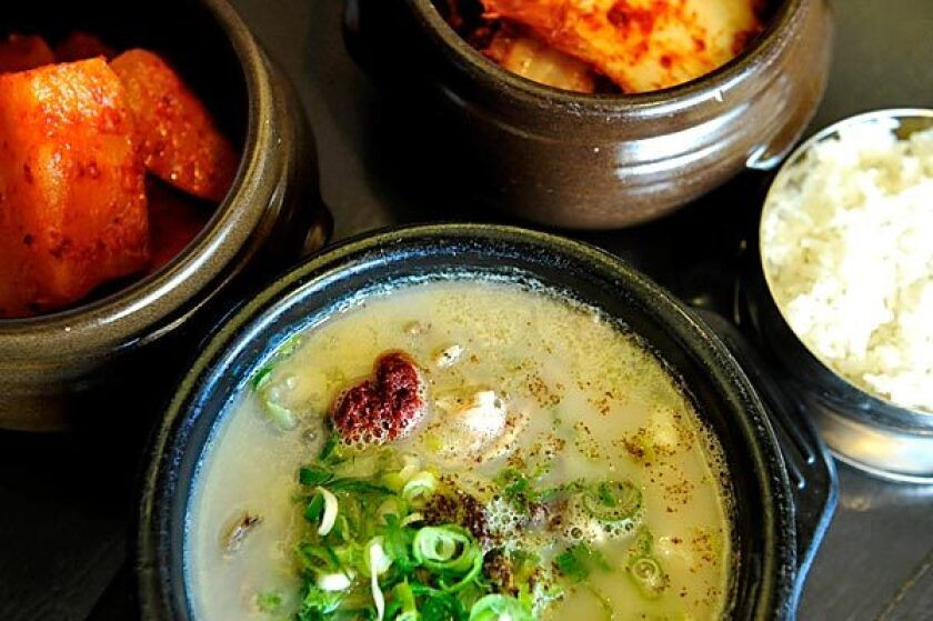 Moobongri Soondae's soondaekook soup is seasoned to taste at the table with ingredients such as spring onions, mustard seed and chile paste.