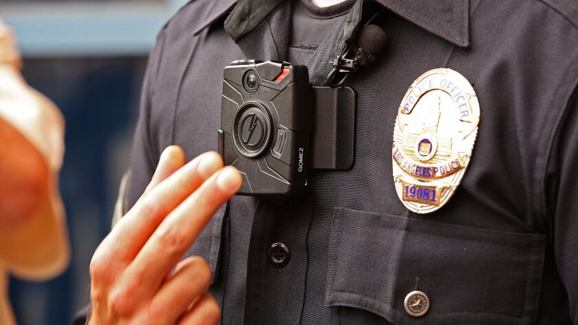 Los Angeles Police Officer Jim Stover demonstrates a new LAPD body camera on Sept. 4, 2015.