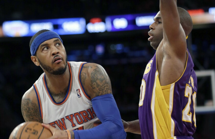 Knicks forward Carmelo Anthony eyes the basket as Lakers guard Jodie Meeks plays tight defense during L.A.'s 110-103 loss on Jan. 26.